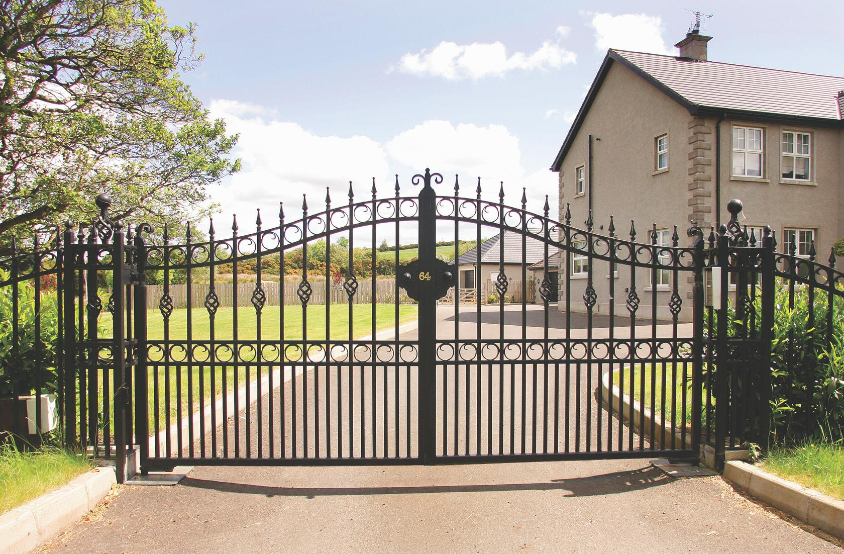 Bespoke Iron Pillars Complimenting The Driveway Entrance
